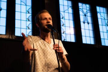 Jacob Adriani on stage (Comedy Spotlight)